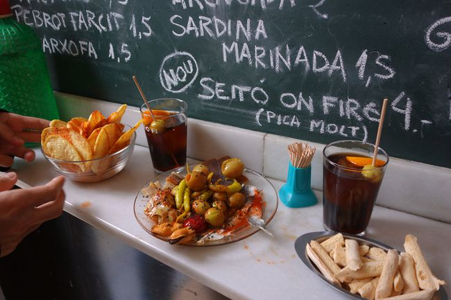Standing at a bar with a sampler of tapas and chalkboard specials on the wall is a quintessential Spain experience. (photo: Rick Steves)