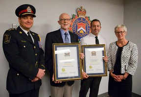 London Police chief John Pare stands with Michael Gregson and Derek Flynn who were awarded for helping a child who was stabbed. (MIKE HENSEN, The London Free Press)