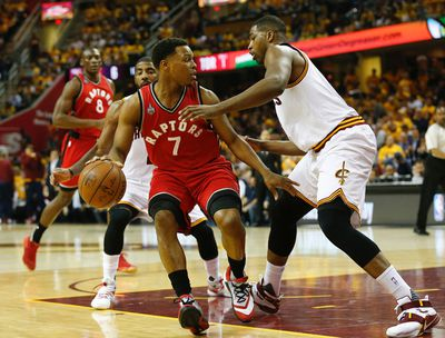 Toronto Raptors Kyle Lowry (7) goes up against Cleveland Cavaliers Kyrie Irving (2) in the first quarter of Game 2 in Cleveland on Thursday May 19, 2016. Jack Boland/Toronto Sun/Postmedia Network