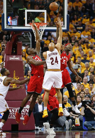 Toronto Raptors Bismack Biyombo (8) and Terrence Ross double team Cleveland Cavaliers Richard Jefferson (24) in the first quarter of Game 2 in Cleveland on Thursday May 19, 2016. Jack Boland/Toronto Sun/Postmedia Network