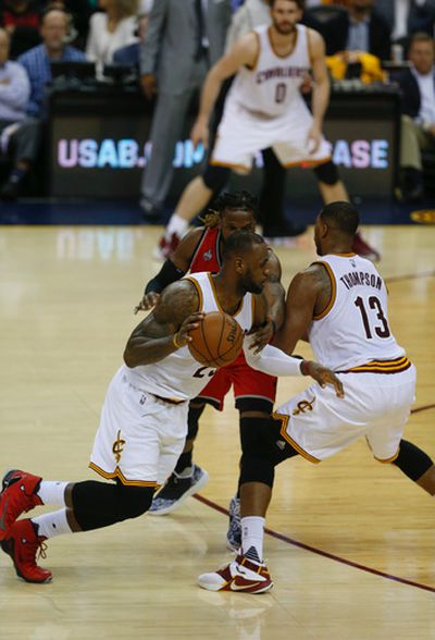 Cleveland Cavaliers LeBron James (23) uses the screen of Thompson (13) to get past Toronto Raptors DeMarre Carroll in the third quarter of Game 2 in Cleveland on Friday May 20, 2016. Jack Boland/Toronto Sun/Postmedia Network