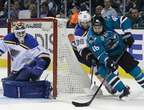 San Jose Sharks defenceman Roman Polak (46) skates past St. Louis Blues forward Troy Brouwer (36) to take a shot on goalie Brian Elliott during Game 3 of the Western Conference final Thursday, May 19, 2016, in San Jose, Calif. (AP Photo/Marcio Jose Sanchez)
