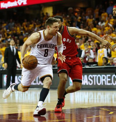 Cleveland Cavaliers Matthew Dellavedova (8) goes past Toronto Raptors Cory Joseph (6) in the fourth quarter of Game 2 in Cleveland on Thursday May 19, 2016. Jack Boland/Toronto Sun/Postmedia Network