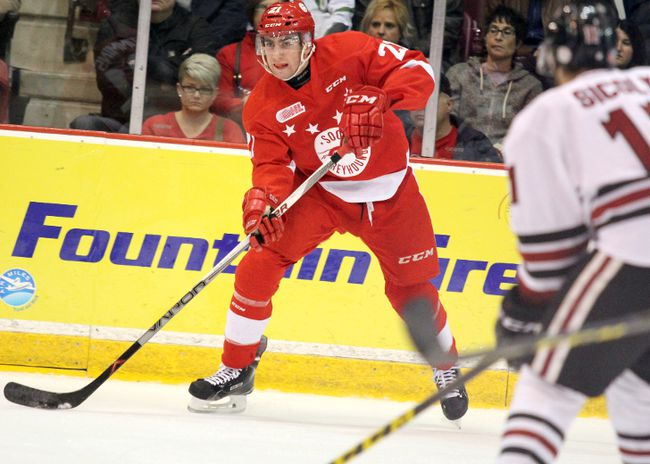 Thorold native Conor Timmins, left, shown defending for the Soo Greyhounds in this file photo, had six shots on net in the team's 8-1 victory over the Niagara IceDogs Saturday night in Sault Ste. Marie.