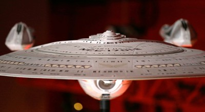 """In this photo taken Wednesday, May 18, 2016, a model of the USS Enterprise (NCC-1701-E), that was led by Capt. Jean-Luc Picard, portrayed by Patrick Stewart, is displayed in the exhibit  """"Star Trek: Exploring New Worlds,"""" as part of a 50th anniversary celebration of the Star Trek franchise at the EMP Museum, in Seattle. The exhibit opens on Saturday. (AP Photo/Elaine Thompson)"""