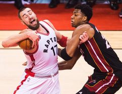 Toronto Raptors centre Jonas Valanciunas (17) runs into Miami Heat centre Hassan Whiteside (21) during NBA playoff action in Toronto on Thursday, May 5, 2016. (THE CANADIAN PRESS/Nathan Denette)