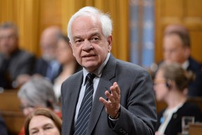 "Immigration Minister John McCallum during Question Period in the House of Commons on Parliament Hill in Ottawa on May 5, 2016. McCallum has apologized for commenting at a Senate committee hearing Wednesday that a ""cultural element"" may explain many Syrian refugees lining up at food banks. THE CANADIAN PRESS/Adrian Wyld"