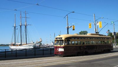 """What a great way to explore Toronto's ever changing waterfront. Every Sunday (starting today) ride the rails (the ones with an unique 4' 10⅞"""" gauge) on board one of the TTC's 1950s-era streetcars. And even better, your discovery ride is free! This year, after a lengthy period without the Sunday Heritage Streetcar"""" as Queen's Quay W. between Bay and Bathurst streets was being redesigned and rebuilt, the TTC is once again presenting free rides on one of its Presidents' Conference Committee (PCC) Streamliners. The car will operate from about 11am to 5 pm every Sunday, starting today, until Labour Day weekend. Catch the historic PCC at any stop along the Queen's Quay W., lower Bathurst St. and Fleet St. route. (Mike Filey photo)"""