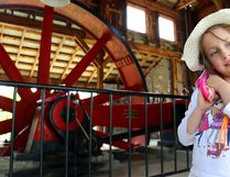 Fyre Larabee, 6, of Wellington cocks her folded umbrella over her shoulder while standing near the steam engine Sunday at Ameliasburgh Heritage Village. See more photos in the print editions of Tuesday's Intelligencer and Thursday's County Weekly News.
