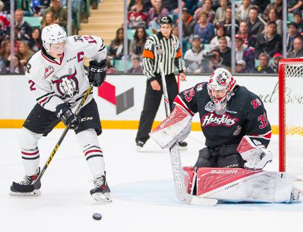 Red Deer Rebels captain Luke Philp looks for the puck as Rouyn-Noranda Huskies goaltender Chase Marchand prepares to make a save during a Memorial Cup game at the Enmax Centrium in Red Deer, Alta. on Sunday, May 22, 2016. Rob Wallator/ CHL Images