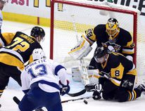 Pittsburgh Penguins right wing Patric Hornqvist (72) and defenseman Brian Dumoulin (8) and goalie Marc-Andre Fleury (29) defend a shot on goal by Tampa Bay Lightning center Cedric Paquette (13) during the second period in game five of the Eastern Conference Final of the 2016 Stanley Cup Playoffs at the CONSOL Energy Center, May 22, 2016. (Charles LeClaire-USA TODAY Sports)