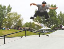 Calgary's Tom Nelner, one of nine pro skaters at the grand reopening of Vulcan's skate park, performs a kick-flip on one of the park's new ramps.