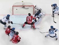 Canada's Connor McDavid, center, scores against Finland's goalie Mikko Koskinen during the Hockey World Championships final match between Finland and Canada, in Moscow, Russia, on Sunday, May 22, 2016. (AP Photo/Ivan Sekretarev)