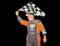 <p>Danny Johnson waves the checkered flag on the hood of his car, after his big win at Cornwall Motor Speedway on Sunday. </p><p>Handout/Cornwall Standard-Freeholder/Postmedia Network