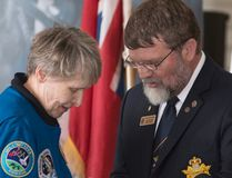 Roberta Bondar accepts a pin from Craig Hawkins, past chair, Ontario provincial committee, Air Cadet League of Canada, in recognition of Bondar becoming an honorary air cadet. Ali Pearson/Sault This Week
