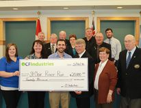 Members of CF Industries present a cheque to the St. Clair River Run committee and St. Clair Township during council's May 16 meeting. CARL HNATYSHYN/SARNIA THIS WEEK