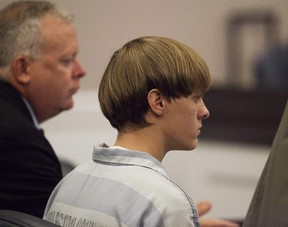 Dylann Roof (R), the 21-year-old man charged with murdering nine worshippers at a historic black church in Charleston last month, listens to the proceedings with assistant defence attorney William Maguire during a hearing at the Judicial Center in Charleston, South Carolina July 16, 2015. Federal prosecutors will seek the death penalty for Roof. REUTERS/Randall Hill/Files
