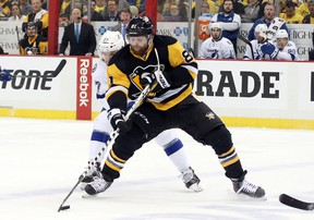 Penguins right wing Phil Kessel (81) carries the puck ahead of Lightning left wing Jonathan Drouin (27) during the NHL's Eastern Conference final in Pittsburgh on May 16, 2016. Kessel and Drouin have become key contributors in the post-season, boosting their chances of playing in the World Cup of Hockey in September. (Charles LeClaire/USA TODAY Sports)