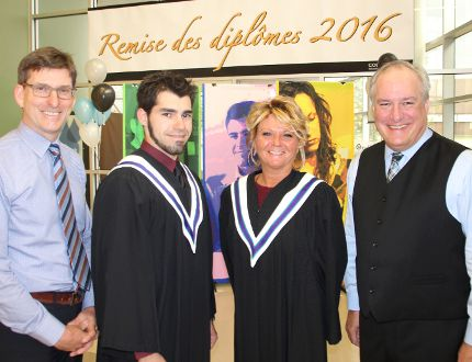 J.P. Nadon, director of Collège Boréal Timmins campus, left, and college president Pierre Riopel, right stand with two grads from the class of 2016, Catherine Gravel and Benoit Babineau, before graduation ceremonies began on Tuesday evening.