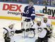 Tampa Bay Lightning goalie Andrei Vasilevskiy, of Russia, looks up as Pittsburgh Penguins defensemen Kris Letang and Olli Maatta, of Finland, congratulate each other during the third period of Game 6. (AP Photo/Brian Blanco)