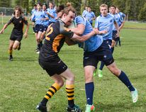 Duncan Thorburn of the Banff Community High School Bears makes a tackle during a rugby match against Strathcona-Tweedsmuir School at the Banff recreation grounds on Wednesday, May 18, 2016. (Daniel Katz/ Crag & Canyon/ Postmedia Network)