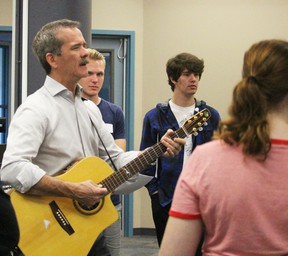 "Retired Canadian astronaut Chris Hadfield performs his song ""Feet Up"" in front of students from the Lambton Kent District School Board Wednesday. Students recorded his song during an audio recording workshop at the inaugural specialist high skills majors conference held at Lambton College.  (Barbara Simpson/Sarnia Observer/Postmedia Network)"