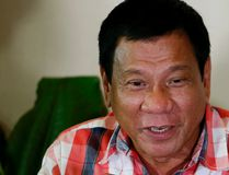In this May 9, 2016, file photo, then front-running presidential candidate Mayor Rodrigo Duterte gestures during his second news conference after voting in his hometown in Davao city in southern Philippines. (AP Photo/Bullit Marquez, File)
