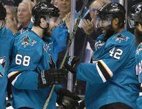 San Jose Sharks forward Joel Ward (42) celebrates his goal with teammate Melker Karlsson (68) during Game 6 of the Western Conference final against the St. Louis Blues Wednesday, May 25, 2016, in San Jose, Calif. (AP Photo/Marcio Jose Sanchez)