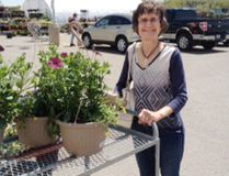 Diana Simpson with her hanging baskets purchased at the Hanover Library sale at Canadian Tire. (Submitted photo)