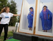 Emily Mountney-Lessard photos/The Intelligencer Students from Campbellford's Kent Public School learn about the difference between water efficient shower heads and traditional shower heads during the Quinte Children's Water Festival at Batawa Ski Hill on Thursday.