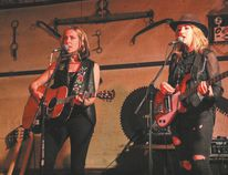 Amanda Rheaume performed songs from her new album, her previous album and some covers of old classics at the Auditorium Hotel one Friday, May 20. (From left) Amanda Rheaume and Anna Ruddick perform to a lively crowd at the Auditorium Hotel.