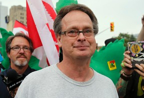 Marijuana advocate Marc Emery walks down a street followed by his supporters following his release from an American prison for selling marijuana seeds in the U.S., in Windsor, Ontario August 12, 2014. REUTERS/Rebecca Cook
