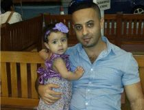 Osama Al-Raboai and his one-year-old daughter Nada.