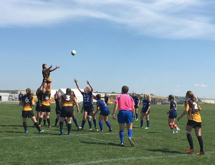 Kendra Pecsi of the Banff Communty High School High School Bears catches a ball thrown from a lineout during a Division 3 rugby playoff match against Highwood High School at the Calgary Rugby Union in Calgary on Wednesday, May 25, 2016. (Photo courtesy of Maya Capel)