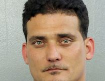 In this photo made available by the Broward County's Sheriff's Office shows Sigfredo Garcia under arrest on Wednesday, May 25, 2016. Garcia, 34, was arrested on a cocaine possession. He is also a suspect in the killing of a well-known Florida State University professor. Daniel Markel was shot in the head inside his garage in Tallahasse, Fla., in July 2014. (Broward County Sheriff's Office via AP)