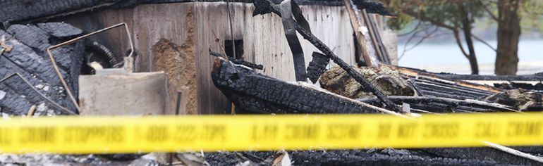 <p>An investigator with the Ontario Office of the Fire Marshal is on the scene at Killarney Mountain Lodge, where an early morning blaze destroyed a building worth $3 million to $4 million in Killarney, Ont. on Thursday May 26, 2016. John Lappa/Sudbury Star/Postmedia Network