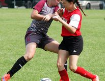 Wallaceburg Tartans' Jaimi Chauvin, left, battles for the ball with a Brennan Cardinals player in the SWOSSAA 'AA' senior girls soccer final Thursday at Steinhoff Park in Wallaceburg. (DAVID GOUGH/Postmedia Network)