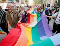 A long pride flag is carried during the Calgary Pride Parade in downtown Calgary on Sunday, September 2, 2012. (LYLE ASPINALL/CALGARY SUN)