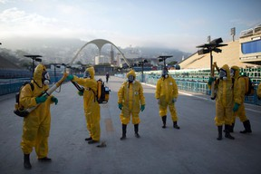 In this Jan. 26, 2016  file photo, health workers get ready to spray insecticide to combat the Aedes aegypti mosquitoes that transmits the Zika virus, under the bleachers of the Sambadrome in Rio de Janeiro, which will be used for the Archery competition in the 2016 summer games. (AP Photo/Leo Correa, File)