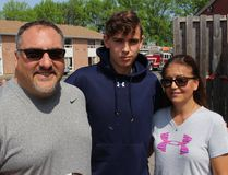 <p>Student Justin Poirier never thought his last day at OHA would be like this, but parents Martin and Isabelle, and many others, are happy there were no injuries at the massive blaze. Photo on Friday, May 27, 2016, in Cornwall, Ont. Todd Hambleton/Cornwall Standard-Freeholder/Postmedia Network