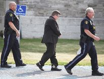 Former Stone Mills Township Ward 1 councillor and financial adviser Kevin Wagar is escorted from a Napanee courthouse in shackles and cuffs on Friday after he was remanded into custody following his sentencing hearing for fraud. (Meghan Balogh/Postmedia Network)