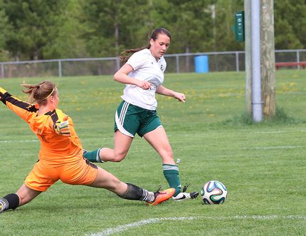 Madison Laberge, right, of Confederation Secondary School, gets by College Notre-Dame goalkeeper Josee Scott during girls AA NOSSA soccer final action at the Howard Armstrong Recreation Centre soccer fields in Hanmer, Ont. on Friday May 27, 2016. Laberge score on the play. John Lappa/Sudbury Star/Postmedia Network