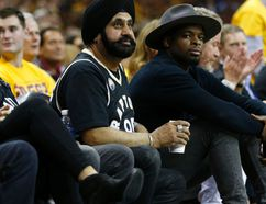 """Super fan"" Nav Bhatia and NHLer P.K. Subban watch the Raptors-Calvaiers game from their courtside seats in the third quarter in Cleveland on May 18, 2016. (Jack Boland/Toronto Sun/Postmedia Network)"