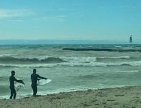 Surfers at Station Beach in Kincardine. (TROY PATTERSON/KINCARDINE NEWS)