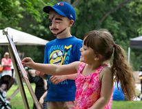 Six-year-old Liam McDermott watches as Macey Thompson, age 4 creates her own masterpiece on Sunday May 29, 2016 at Glenhyrst Art Gallery's Family Arts Day in Brantford, Ontario. Brian Thompson/Brantford Expositor/Postmedia Network