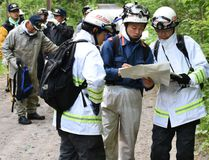 Rescuers serach for a 7-year-old boy who is missing in a Japanese forest in Nanae town, on Hokkaido, the northernmost of Japan's four main islands Monday, May 30, 2016. He has been missing since late Saturday afternoon after his parents reportedly made him get out of the car as punishment. (Kyodo News via AP) J