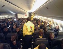 South African firefighters are seen on a an Air Canada plane in Johannesburg, South Africa destined for Edmonton on Sunday May 29, 2016 in this handout photo. Air Canada is flying 300 firefighters from Johannesburg, South Africa to assist with Alberta wild fires. THE CANADIAN PRESS/HO-CNW Group