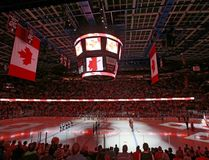 The interior of the Scotiabank Saddledome is lit up for the Canadian anthem in Calgary, Alta., in this Sept. 29, 2015 file photo. (Jim Wells/Calgary Sun/Postmedia Network)