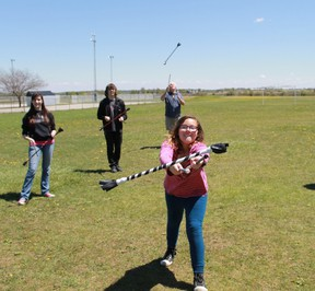 An East Lambton Elementary School student tries to learn how to use a pair of devil sticks during the school's annual Arts Day.  CARL HNATYSHYN/SARNIA THIS WEEK