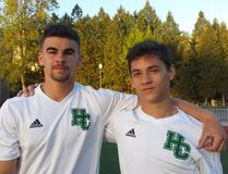 Eric Rebelo, left, and Nino D'Amore of the Holy Cross Crusaders senior boys soccer team. Both of them scored in the Crusaders' 2-1 extra-time victory over the Kingston Blues in the Kingston Area championship game. (Doug Graham/The Whig-Standard)
